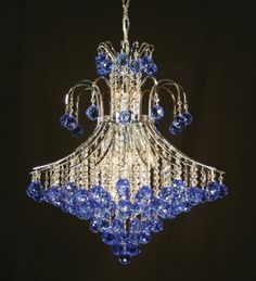bold blue multifaceted crystal spheres in Strauss Lighting's Concorde Crystal Sphere, Color Azul, Special Events, Design Trends, Chandelier, Ceiling Lights, Concorde, Crystals, Lighting