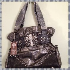 """NWT RHINESTONE STUDDED MEDIEVAL CROSS New with tags black handbag studded with rhinestones. Two outside side pockets. One inside zippered compartment and two smaller inside open pockets. Bottom base measures 14 1/2"""" X 4"""". Straps are 21"""". Halo Bags"""
