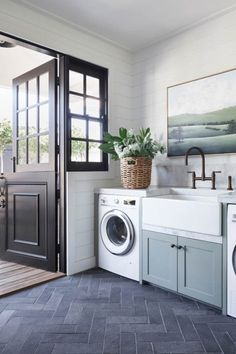 Studio McGee laundry room with modern coastal laundry room with blue cabinets an. Studio McGee laundry room with modern coastal laundry room with blue cabinets and farmhouse sink and bronze faucet with . Mudroom Laundry Room, Laundry Room Cabinets, Farmhouse Laundry Room, Blue Cabinets, Laundry Room Design, Farmhouse Cabinets, Farmhouse Faucet, Bathroom Laundry, Coastal Farmhouse