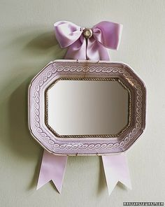 Platter Mirror: Just because an antique platter or plate is scratched, cracked, or broken, its useful life doesn't have to end. Its patterned border can be used as the decorative frame for a mirror. Martha Stewart