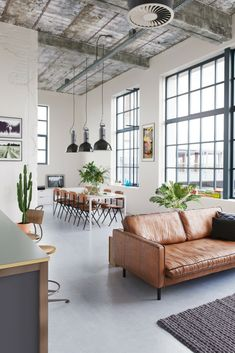 6 Important Considerations About Loft Living Space And Style [Loft Design Ideas, Loft Decor, Scandinavian Decor, Leather Sofa, Concrete Floors, Open Concept Living Room, Indoor Plants, Scandinavian Loft]