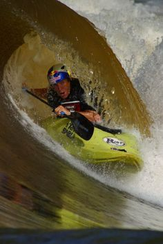 Whitewater Kayaking photos by Red Bull. Very famous kayak surf wave on the Zambezi, Steve Fisher getting the tube.