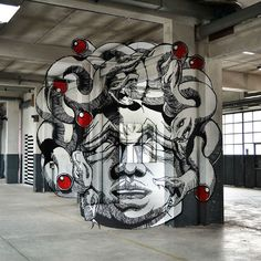 Medusa Anamorph:  Artists Ninja1 and Mach505 create a terrifying – and awesome – 3D vision of Medusa using various surfaces in a factory / urban lab.