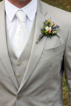 Love this light gray suit with all white tie and under shirt, really classy