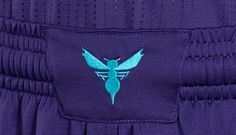 SHORTS · One-color silhouette mark on waistband · Ties to original Hornets uniforms