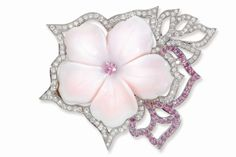Padani 18k white gold flower brooch with pink mother-of-pearl flower adorned with diamonds and pink sapphires.