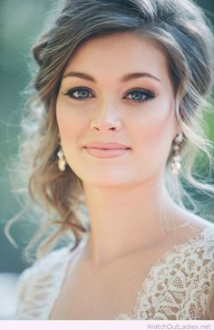 Wedding updo, makeup for blue eyes and lovely earrings