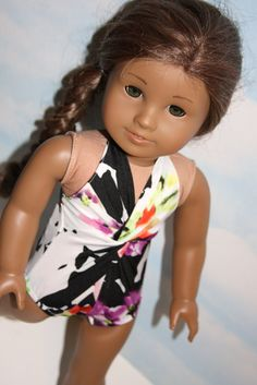 Black and white floral twist front swimsuit by SewLikeBetty on Etsy. Made with The Peppermint Twist Swimsuit and Sarong Wrap pattern, found at http://www.pixiefaire.com/products/the-peppermint-twist-swimsuit-sarong-wrap-18-doll-clothes. #pixiefaire #thepepperminttwistswimsuitandsarongwrap