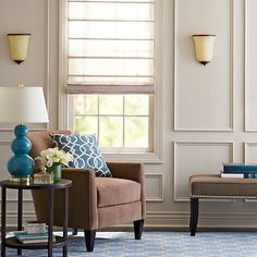 Dress up your living room with millwork. The delicate frames add subtle pattern to the walls and emphasize elements such as art and sconces.
