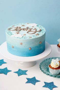 Twinkle Star Baby CakeCelebrate the imminent arrival of a little boy with this adorable baby shower cake. Iced in blue ombre buttercream the cake is decorated with blue and golden sugar stars, a beautiful golden 'Baby' script on a pale blue plaque surroun Torta Baby Shower, Idee Baby Shower, Baby Shower Cakes For Boys, Shower Bebe, Simple Baby Shower, Baby Shower Cupcakes, Baby Boy Shower, Blue Cupcakes, Baby Showers