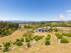 Striking gardens delight the senses, supply the table, and frame beautiful rural and mountain views on this hectare property. Nelson New Zealand, Native Plants, Mountain View, Scenery, Country Roads, The Originals, Beautiful, Landscape, Landscapes