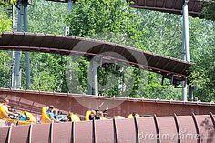 A view over an part of the roller coaster. La Trace de Hourra roller coaster in Park Asterix, Ile De France, France