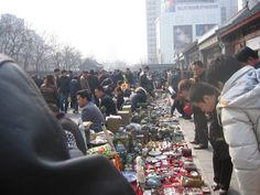 Beijing, China Travel: The Dirt Market is great fun, even if you go just to browse the genuine and reproduction antiques as well as paintings, jewelry, and other products. Be sure to bargain hard in Chinese markets, even offering 10 or 20% of the first price asked.