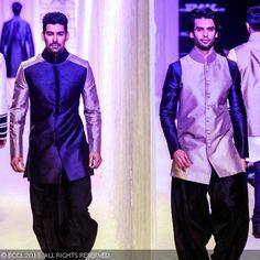 Models showcase creations by fashion designer Manish Malhotra on Day 1 of the Lakme Fashion Week (LFW) Winter/Festive 2013, held at Grand Hyatt, Mumbai, on August 22, 2013.