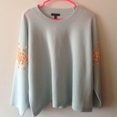 J.CREW Egg Blue Sequined Sleeve So gorgeous! Size XL from J.Crew. New with tags! This is the most perfect oversized chic sweater. Light egg blue with peach colored sequins on middle of sleeve. Loose sleeves (see 4th pic) J. Crew Sweaters Crew & Scoop Necks