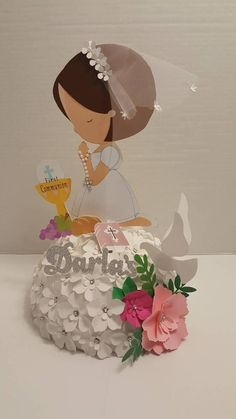 Beautiful communion centerpiece is about 18W. and about 17 H. Is made out of paper . Process time : It will take about 2 to 3 days for one piece, plus shipping days, if you are in NY. It will take about 2 to 4 days. If you are out of state, 5 to 10 days. The girl, sing and colors can