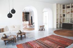 San Giorgio Hotel, Mykonos Like the hanging chairs, the shelving and the double arches