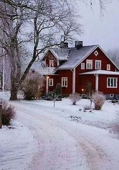 Pretty red house this is so inviting on a snowy day with a warm fire going and candles in every window. Winter cottage please!