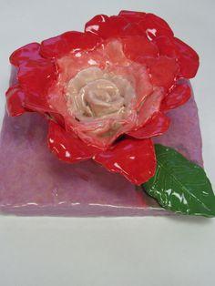 "4th grade ceramic rose sculpture (3rd view) approx. 7""x 7""; lesson designed by art teacher: Susan Joe"