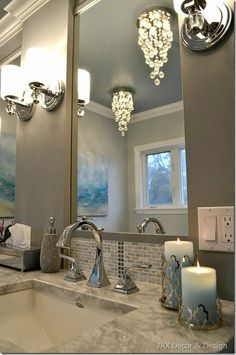Master bathroom lighting - JAX Decor Design. This works for me. Lights between the mirrors and chandler by tub