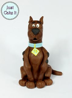 Fondant Scooby Doo cake topper tutorial here https://www.youtube.com/watch?v=SNr6-mWWFtI