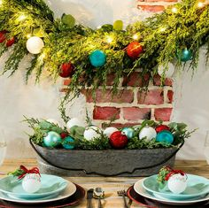 Mix ornaments with greenery for festive cheer in your cozy home!
