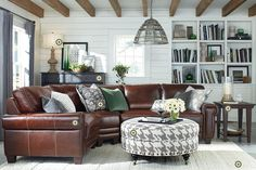 Bassett Rooms We Love * custom ottoman round ottoman :: printed novelty linen 5094-1 ** (for a chair iLO sectional) saddle leather 7125-18 ** great for the library or the ottoman in the family room *