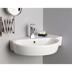 """Cheviot Barcelona Wall Mount Sink $184 Width: 23-5/8"""" Depth: 5-1/8"""" Note: A small permanent manufacturer stamp is visible on the side of this sink"""