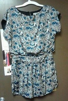 """BCBGeneration  Size 8  Floral, casual dress  Rayon Nylon blend  Preowned, Excellent Condition  Lined  Measures 20 inches from armpit to armpit, 34 inches long, and 16 inches waist (32"""" all around waist)."""