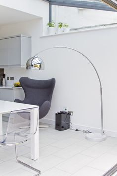 A light, airy, modern space in Russell's Chichester home. Featuring our Large Bow Lamp. See more of Russell's home on MADE Unboxed.