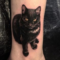 Hyper-realistic black cat tattoo by Paulo Lopes