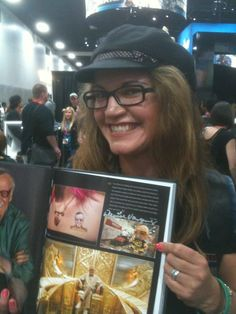 """Artist Denise Vasquez designed & created the Custom Stan Lee Vinyl Munny Toy, FEATURED in Morgan Spurlocks Book """"Comic Con Episode IV A Fans Hope"""" on page 89 with Stan Lee."""