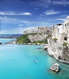 Medieval town of Vieste perched on cliff ridge | Puglia