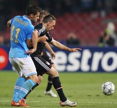 Christian Maggio (L) of SSC Napoli competes for the ball with Franck Ribery of FC Bayern Muenchen during the UEFA Champions League Group A match between SSC Napoli and FC Bayern Muenchen at Stadio San Paolo on October 18, 2011 in Naples, Italy.