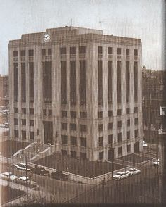"The 1125 Locust Police Headquarters Building, Nov. 19, 1938. Attracted over 25,000 visitors within the first month of its opening, It was built after many hours of study of all police station needs and under the direction of Director of Police, Otto P. Higgins. The cost of the building was approximately 1 million dollars and was financed under the ""Ten-Year-Plan of Civic Improvements."""