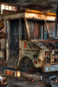 HDR version of an abandoned delivery step van amongst the ruins of the Detroit Packard Plant.  View On Black