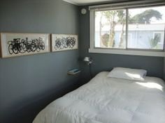 Small Space Solution: No Space Night Stands. Love the gray walls and bicycle artwork