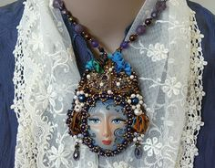 Bead embroidered Pendant necklace Goddess shibori silk ribbon Beadwork Ooak seed beaded textile jewelry art doll godess by MaewaDesign on Etsy https://www.etsy.com/listing/285954353/bead-embroidered-pendant-necklace