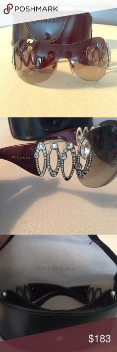 Bvlgari crystal sunglasses Gorgeous pair of bvlgari sunglasses! Comes with case. Sunglasses are in excellent condition. The case is worn though. Originally $800!!! Amazing deal for 183 bvlgari Accessories Sunglasses