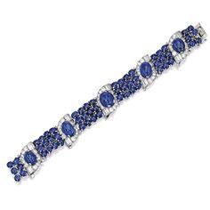 I seriously want one of these jeweled bracelets Platinum, Sapphire and Diamond Bracelet, J.E. Caldwell