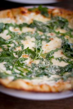 arugula on rustic white sauce pizza add sausage & prosciutto.