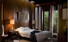 A Single Man: The wood paneled master bedroom of the Schaffer House.