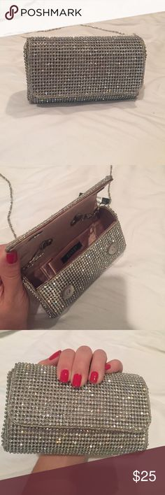 Clutch/purse New clutch that goes with any outfit. The strap can either be tucked in the purse to act as a clutch or use the strap to hang over shoulder. My iPhone 6 can fit inside. Also perfect to just hold cash, lipgloss, ID, etc! Rsvp Bags Clutches & Wristlets