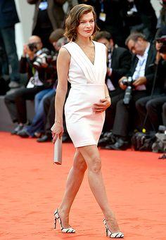 e2fcf377d8 Pregnant Milla Jovovich Debuts Bump in Venice