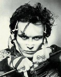 Adam Ant.  Saw him in a street show in Philly.  They block off part of a city street and everybody's dancing in the street.  Those were the mescaline days!