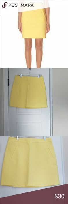 The Limited Textured Yellow Skirt Excellent condition. No signs of wear. Size 10. Two front pockets. Zips in the back. 16 in across the waist. 18.75 in Long. About 20 inch across the hips and butt. Spring style and work week chic. Has a lining underneath. The Limited Skirts Midi