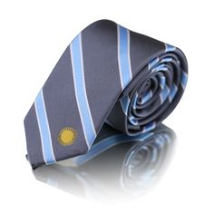 Argentina Necktie - The Argentina Tie, by The Town and Co. Known for bright and bold Albi Celeste colors, Argentina's flag is blue and white, and proudly shows the Sol de Mayo symbol. This Argentina necktie not only represents Argentinian style and grace, but also its country's pride.