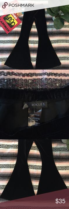 """Black Stretch Velvet Super Flare Bell Bottoms This is an absolutely killer pair of Velvet bell bottoms by the brand Rogue in a size L. These high rise black beauties are a plush thick stretch velvet with a massive bell! In perfect condition, only worn once! Elastic waist. Tag is detached on one side. Measurements (taken flat): waist 13"""" unstretched/ 20"""" stretched max, rise 10"""", inseam 32"""", bell 18 1/2"""". Like Free People, Spell, Gypsy Warrior, Pylo, Nasty Gal, UNIF, Dollskill, Killstar…"""