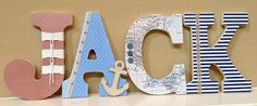 Love this idea for covering letters, and I don't even like letters in the nursery - nautical nursery