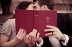 Cute engagement photo. Couple kissing behind a book. Matt Kennedy - Portfolio Photo By www.mattkennedy.ca